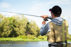 A young man fishing Royalty Free Stock Images