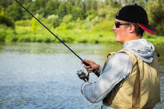 A young man fishing Royalty Free Stock Image