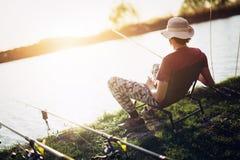Young man fishing at pond and enjoying hobby. Activities Stock Photography