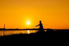 Young man fishing at river Royalty Free Stock Photos