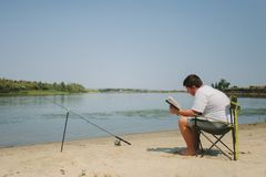 Young man fishing stock images