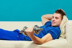 Young man fit body relaxing on couch after training Stock Photography