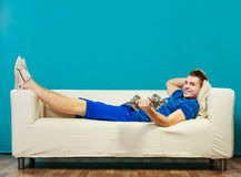 Young man fit body relaxing on couch after training Royalty Free Stock Photography