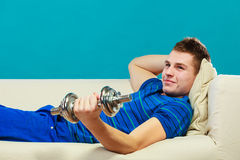 Young man fit body relaxing on couch after training Stock Images