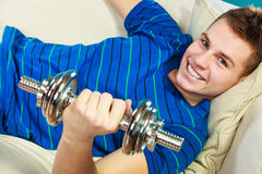 Young man fit body relaxing on couch after training Royalty Free Stock Image