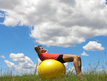 YOUNG MAN ON FITNESS BALL Stock Image