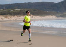 Young Man In Fitness Clothing Running Along Beach Royalty Free Stock Photo