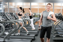 Young man in fitness club Royalty Free Stock Images