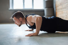 Young man fitness workout, push ups or plank Royalty Free Stock Images