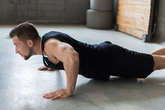 Young man fitness workout, push ups or plank Royalty Free Stock Photography
