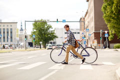 Young man with fixed gear bicycle on crosswalk Stock Photography