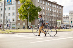 Young man with fixed gear bicycle on crosswalk Royalty Free Stock Photography