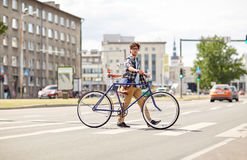 Young man with fixed gear bicycle on crosswalk Royalty Free Stock Images