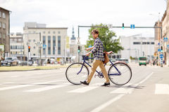 Young man with fixed gear bicycle on crosswalk Royalty Free Stock Image