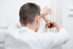 Young man fixing the door handle Stock Photography