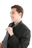 An young man fixing his tie Royalty Free Stock Images