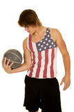 Young man in flag tank top curl medicine ball Stock Images