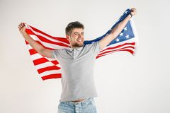 Young man with the flag of United States of America royalty free stock image