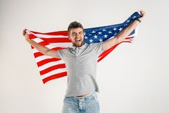 Young man with the flag of United States of America royalty free stock images