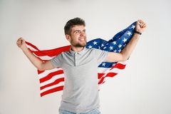 Young man with the flag of United States of America stock images