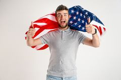 Young man with the flag of United States of America stock photo