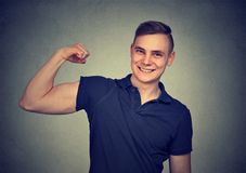 Young Man flexing his bicep royalty free stock photos