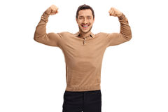 Young man flexing his biceps Royalty Free Stock Photo