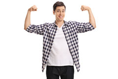 Young man flexing his muscles Royalty Free Stock Image