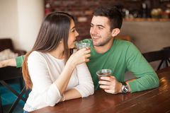 Young man flirting with a girl at the bar Stock Photo