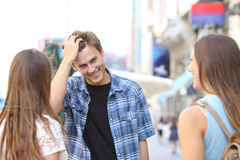 Young man flirting with two girls Royalty Free Stock Photo