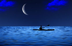 Young man floating on the canoe in the sea at starry night with moon background and clouds Royalty Free Stock Photography