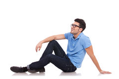 Young man on the floor looking away Royalty Free Stock Photo