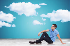Young man on the floor looking away to clouds Royalty Free Stock Images