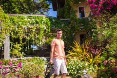 Young man in a flower garden at the exotic resort Stock Photo