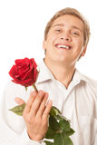 Young man with a flower in her hand Royalty Free Stock Photo