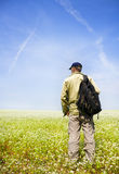 Young man on flower meadow. Royalty Free Stock Photo
