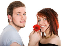 Young man with flower and pretty girl Stock Photos