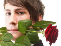 Young man, flower, red rose isolated Royalty Free Stock Photos