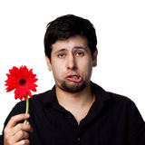 Young man with flowers stock photo