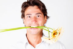 Young man with flowers Royalty Free Stock Photos