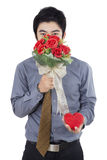 Young Man with Flowers and A Gift Stock Images
