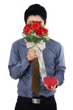 Young man with flowers Stock Photography
