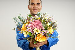 Young man with flowers Stock Images