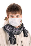 Young Man in Flu Mask Stock Images