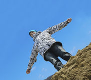 Young man flying above a rock Stock Photography