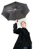 Young man flying away with umbrella Royalty Free Stock Photos