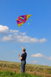 Young man flying a kite Royalty Free Stock Photo