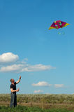 Young man flying a kite Stock Image