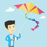 Young man flying kite vector illustration. Stock Images