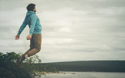 Young Man Flying levitation jumping outdoor Royalty Free Stock Image